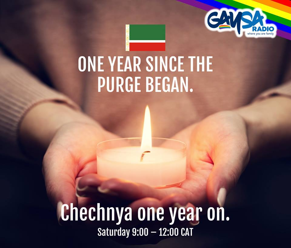 This is a picture of two hands holding a candle which is burning to mark the one year anniversary of the atrocities against gay men in Chechnya. The words on the picture says One year sine the purge began, Chechnya one year on